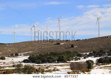 Aerogenerator Electric Windmills On Snow Mountain