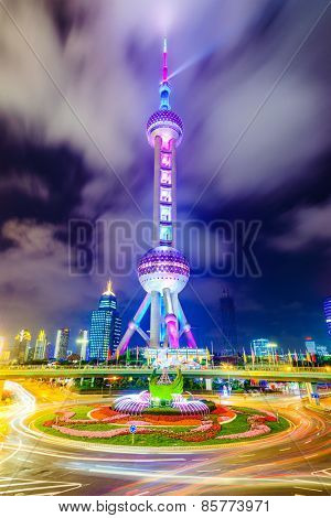 SHANGHAI, CHINA - JUNE 18, 2014: The landmark Oriental Pearl Tower at night in Lujiazui Financial District. The tower was the tallest building in China from 1994-2007.