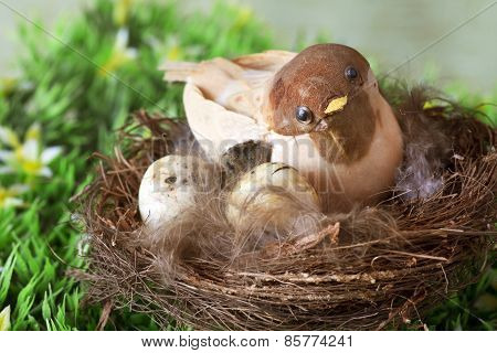 decoartive little sparrow inside nest