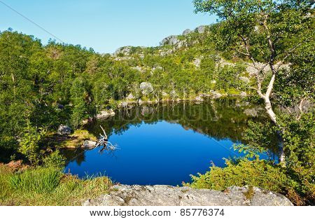 Deep Blue Mountain Lake On Norway