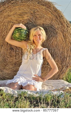 Happy woman posing with watermelon