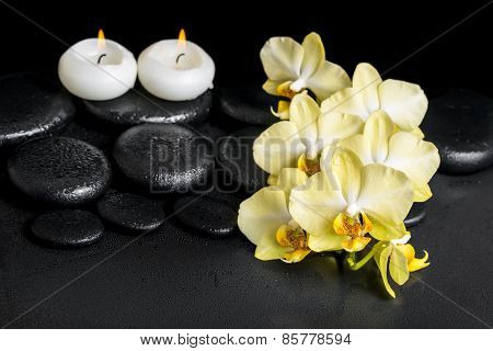 Beautiful Spa Setting Of Yellow Orchid Phalaenopsis And Candles On Black Zen Stones With Drops, Clos