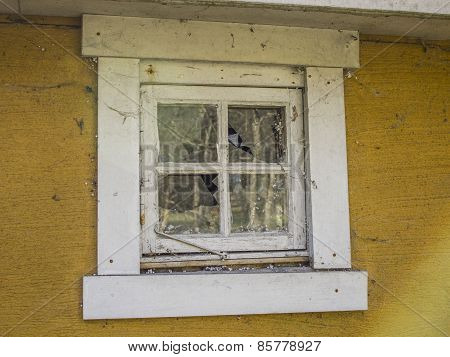 Abandoned Yellow House With Broken Window