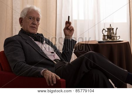 Senior Millionaire Smoking Cigar