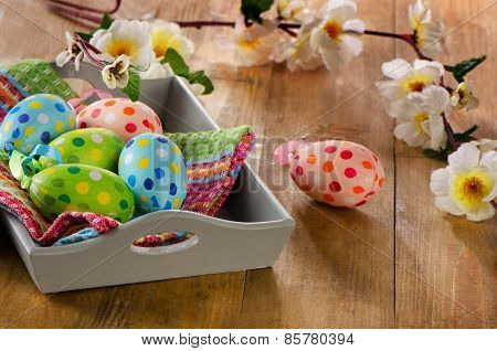 Easter Eggs In  Wooden Box On A Wooden Background