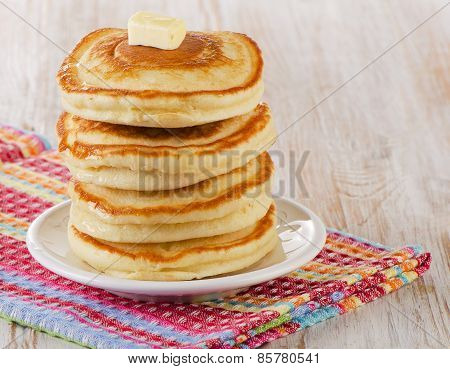 Stack Of Small Pancakes On A Wooden Table.