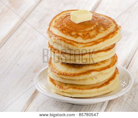Stack Of Small Pancakes On  Wooden Table