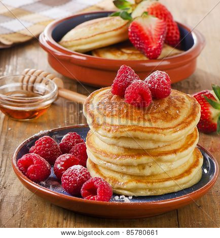 Small Pancakes With Fresh Raspberries And  Butter