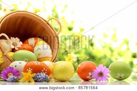 Basket of eggs on a green background for Easter