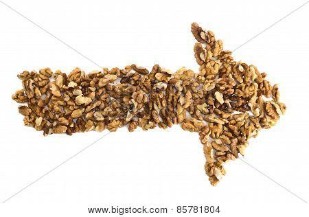 Arrow shape made of walnuts