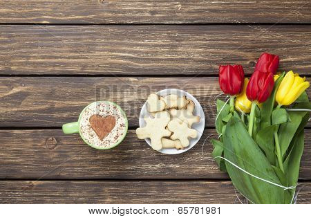 Cup Of Cappuccino With Heart Shape And Bouquet Of Tulips With Cookies