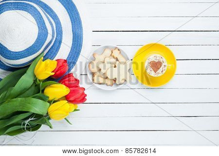 Hat With Tulips And Cappuccino With Cookies