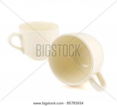 Two ceramic cream colored cups composition