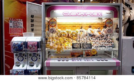 Osaka, Japan- March 2015-Toy Crane Vending Machine along the street in shopping area