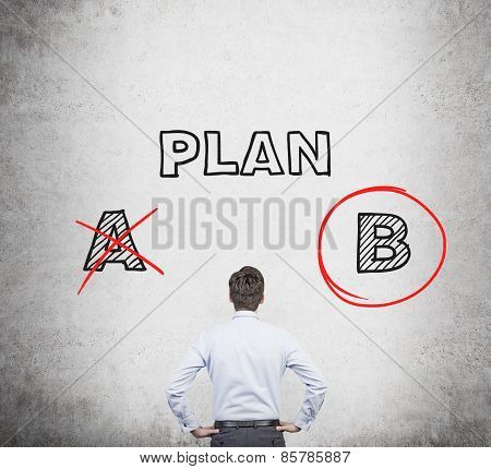 Businessman Looking At Drawing Plan