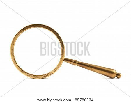 Old metal magnifying glass isolated