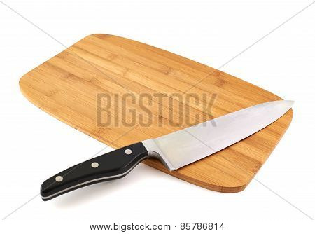 Knife over wooden cutting board