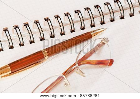Pen, Notebook And Glasses