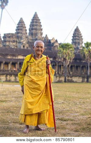 An Unidentified Old Buddhist Female Monk Dressed In Orange Toga At Angkor Wat Temple.