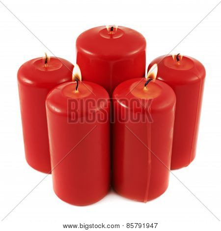 Five lighted candles composition isolated