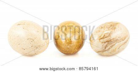 Three egg shaped stones