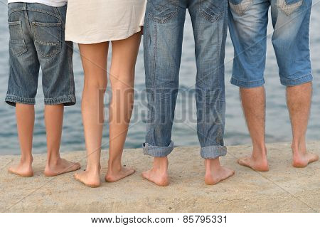 Family feet on beach