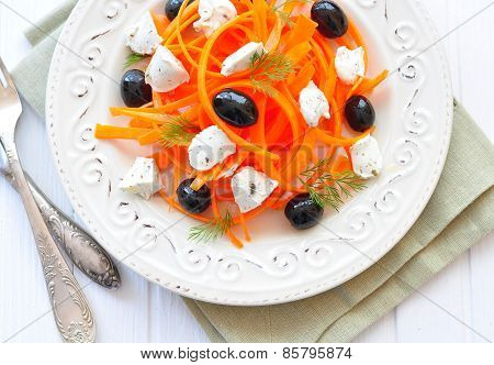 Carrot pasta salad with feta, olivs and dill