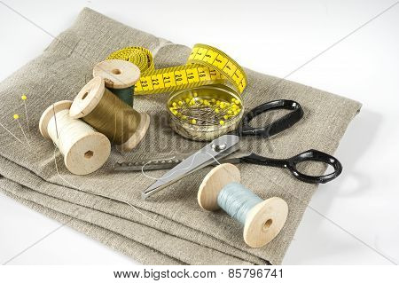 Sewing utensils on white