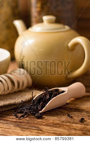 Wooden Spoon Full Of Dry Tea Leafs