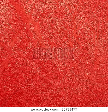 Artificial red leather material fragment