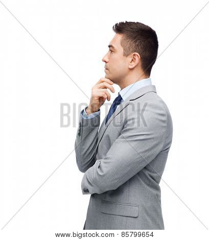 business, people and office concept - thinking businessman in suit making decision