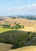 stock photo of senesi  - Crete senesi characteristic landscape in province of Siena Tuscany Italy - JPG