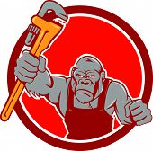 stock photo of plumber  - Illustration of an angry gorilla ape plumber with monkey wrench punching facing front set inside circle on isolated background done in cartoon style - JPG