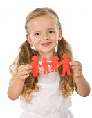 Little Girl Holding Paper People - Family Concept