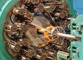 stock photo of braids  - Braiding machine for weaving flexible metal hose taken closeup - JPG