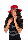 stock photo of woman red blouse  - A lovely African American woman in a black blouse and long black curly