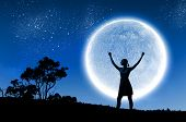 pic of moon silhouette  - Silhouette of woman against full moon with hands up - JPG