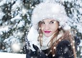 picture of snowball-fight  - Girl preparing a snowball for a snowball fight - JPG