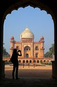pic of mughal  - Tomb of Safdarjung seen from main gateway with silhouetted person taking photo New Delhi India - JPG