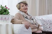 foto of decoupage  - Beauty senior woman sitting on the sofa - JPG