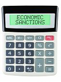 foto of macroeconomics  - Calculator with ECONOMIC SANCTIONS on display isolated on white background - JPG