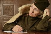 foto of comrades  - Portrait of a happy mature female soldier writing letter - JPG