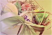 stock photo of easter basket eggs  - Eggs in a basket with hay Easter - JPG
