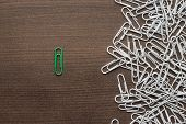 stock photo of uniqueness  - bright green paper clip unique idea concept - JPG