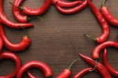 foto of red hot chilli peppers  - red hot chilli peppers on the wooden table with copy space - JPG