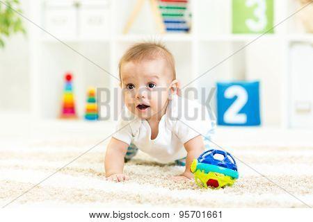 crawling funny baby boy at nursery
