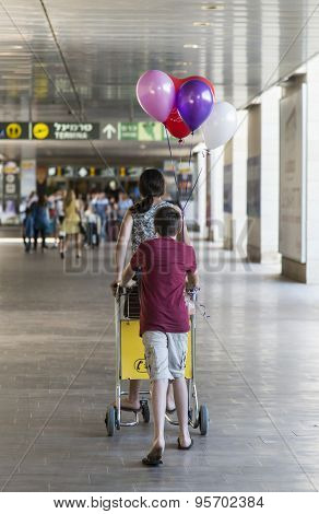 Tel Aviv, Israel June 12, 2015: kids entering Ben Gurion International Airport with welcome balloons