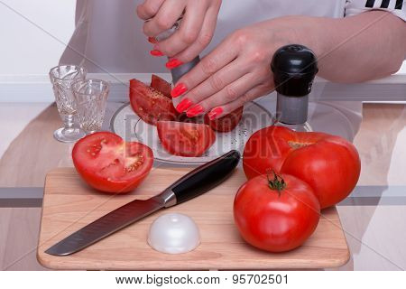 Tomatoes And Knife On A Chopping Board