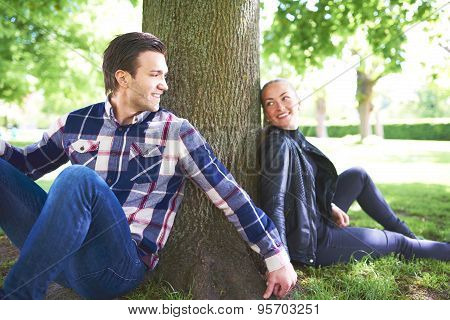 Sweet Lovers Relaxing Under The Shade Of A Tree