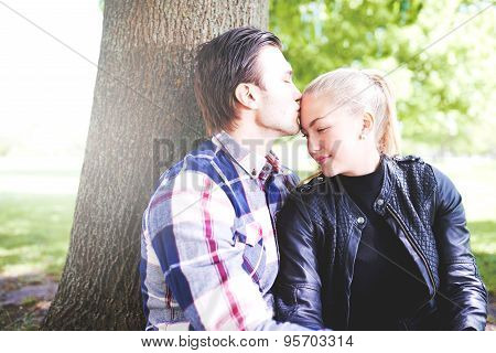 Loving Couple Enjoying A Tender Kiss